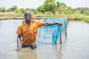 Fish farmer in Zambia. Photo by Chosa Mweemba